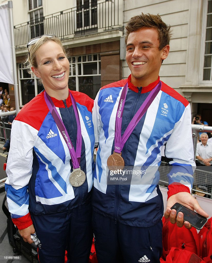 British Olympic silver medal winning equestrian athlete Zara Phillips with her Three Day Event silver medal and British Olympic bronze medal winning diver Tom Daley smile during the London 2012 Victory Parade for Team GB and Paralympic GB athletes on September 10, 2012 in London, England.