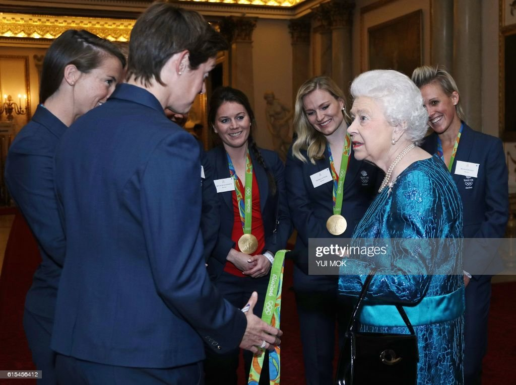 British Olympic womens hockey team players react as they talk with Britain's Queen Elizabeth II, during a reception for Team GB's Olympic and Paralympic athletes, at Buckingham Palace in central London on October 18, 2016. Britain's stars of this year's Olympic and Paralympic Games in Rio attended an 'amazing' reception at Buckingham Palace -- the official London home of Queen Elizabeth II -- on Tuesday. / AFP / POOL / Yui Mok