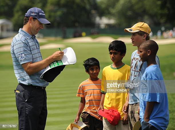 British Open champion Padraig Harrington of Ireland signs autographs for young fans during a practice round for the 90th PGA Championship on August 4...