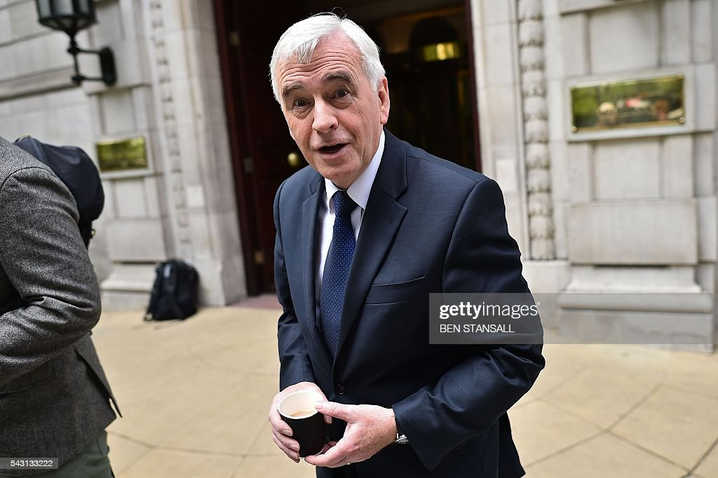 British opposition Labour MP and Shadow Chancellor of the Exchequer John McDonnell leaves from Millbank television and radio studios in central London on June 26, 2016. The future of opposition Labour leader Jeremy Corbyn looked shaky on Sunday after two members of his top team quit and others seemed set to follow over his handling of Britain's EU referendum. Corbyn sacked his foreign affairs spokesman, Hilary Benn, late Saturday after Benn said he no longer had confidence in his leadership, while health spokeswoman Heidi Alexander announced her resignation on Twitter Sunday. / AFP / BEN