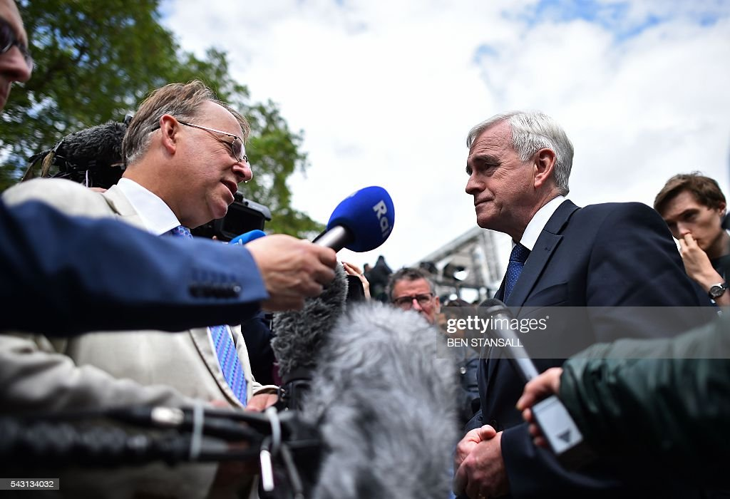 British opposition Labour MP and Shadow Chancellor of the Exchequer John McDonnell speaks during an interview with members of the media near the Houses of Parliament in central London on June 26, 2016. The future of opposition Labour leader Jeremy Corbyn looked shaky on Sunday after two members of his top team quit and others seemed set to follow over his handling of Britain's EU referendum. Corbyn sacked his foreign affairs spokesman, Hilary Benn, late Saturday after Benn said he no longer had confidence in his leadership, while health spokeswoman Heidi Alexander announced her resignation on Twitter Sunday. / AFP / BEN