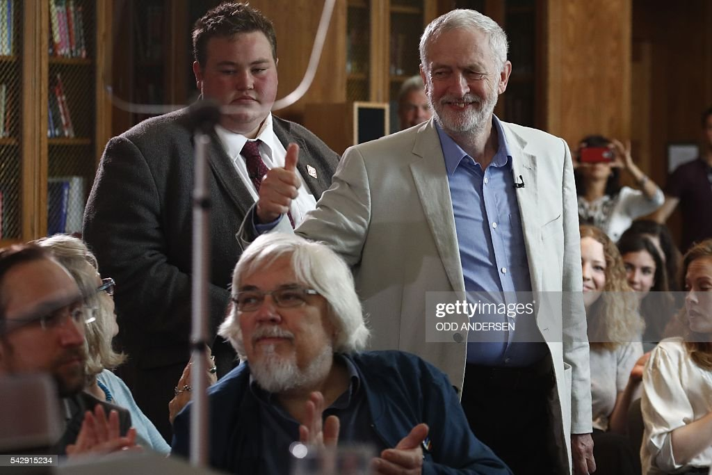 British opposition Labour Party leader Jeremy Corbyn (R) gestures as he arrives to deliver a speech following the pro-Brexit result of the UK's EU referendum vote, in central London on June 25, 2016. The result of Britain's June 23 referendum vote to leave the European Union (EU) has pitted parents against children, cities against rural areas, north against south and university graduates against those with fewer qualifications. Opposition Labour party leader Jeremy Corbyn was widely criticised for his lukewarm campaigning for Remain, and failing to reach out and persuade working class Labour voters who opted for Leave in droves. / AFP / ODD