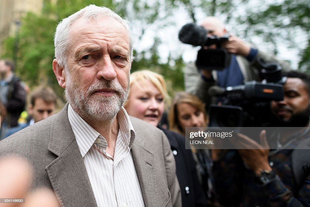 British opposition Labour Party leader Jeremy Corbyn (L) joins steel workers following a protest march through central London on May 25, 2016. Britain's business minister Sajid Javid met Tata Steel bosses in Mumbai ahead of a crunch board meeting on Wednesday expected to discuss potential buyers for its loss-making UK assets. Tata Steel, Britain's biggest steel employer, announced in March that it planned to sell its Port Talbot plant in Wales and other assets, putting 15,000 jobs at risk. / AFP / LEON