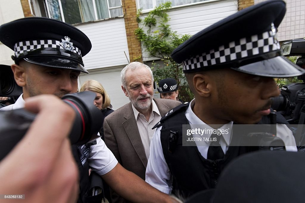 British opposition Labour Party Leader Jeremy Corbyn (C) leaves his home in London on June 27, 2016. Britain's opposition leader Jeremy Corbyn insisted he would not give up his job in a Labour Party revolt over his handling of the EU referendum campaign, as the aftershocks from the 'Leave' vote reverberate around the country. / AFP / JUSTIN