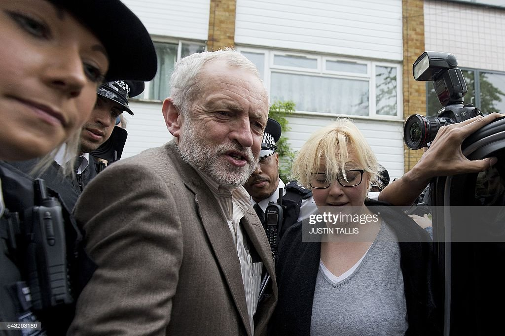 British opposition Labour Party Leader Jeremy Corbyn (2L) leaves his home in London on June 27, 2016. Britain's opposition leader Jeremy Corbyn insisted he would not give up his job in a Labour Party revolt over his handling of the EU referendum campaign, as the aftershocks from the 'Leave' vote reverberate around the country. / AFP / JUSTIN