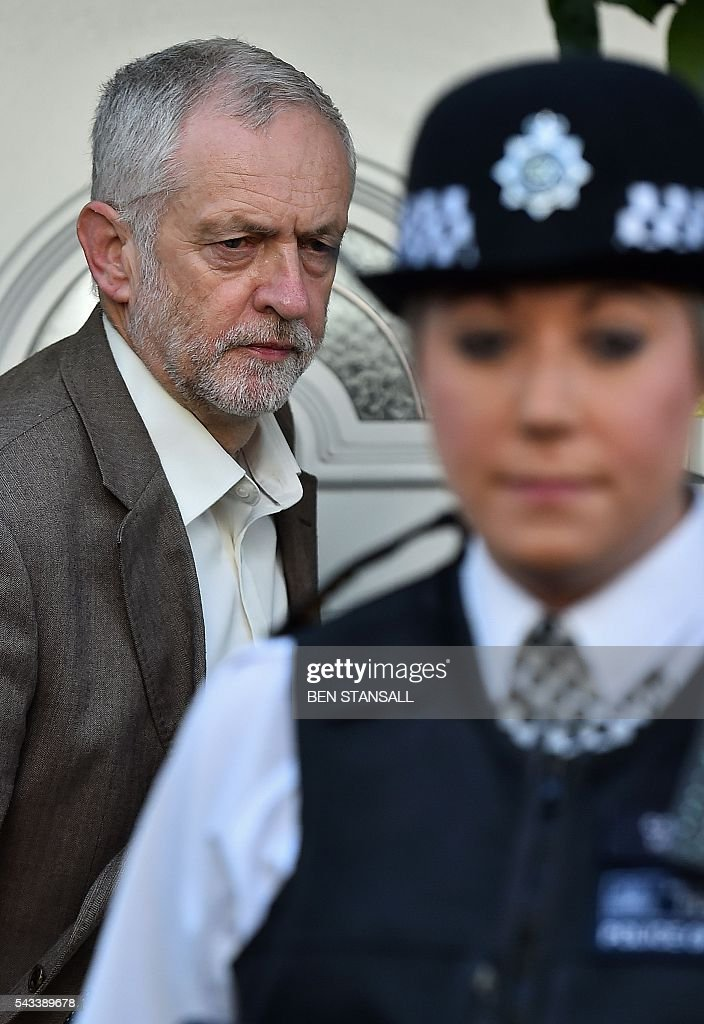 British opposition Labour Party Leader, Jeremy Corbyn (L) leaves his home in London on June 28, 2016. EU leaders attempted to rescue the European project and Prime Minister David Cameron sought to calm fears over Britain's vote to leave the bloc as ratings agencies downgraded the country. Britain has been pitched into uncertainty by the June 23 referendum result, with Cameron announcing his resignation, the economy facing a string of shocks and Scotland making a fresh threat to break away. / AFP / BEN