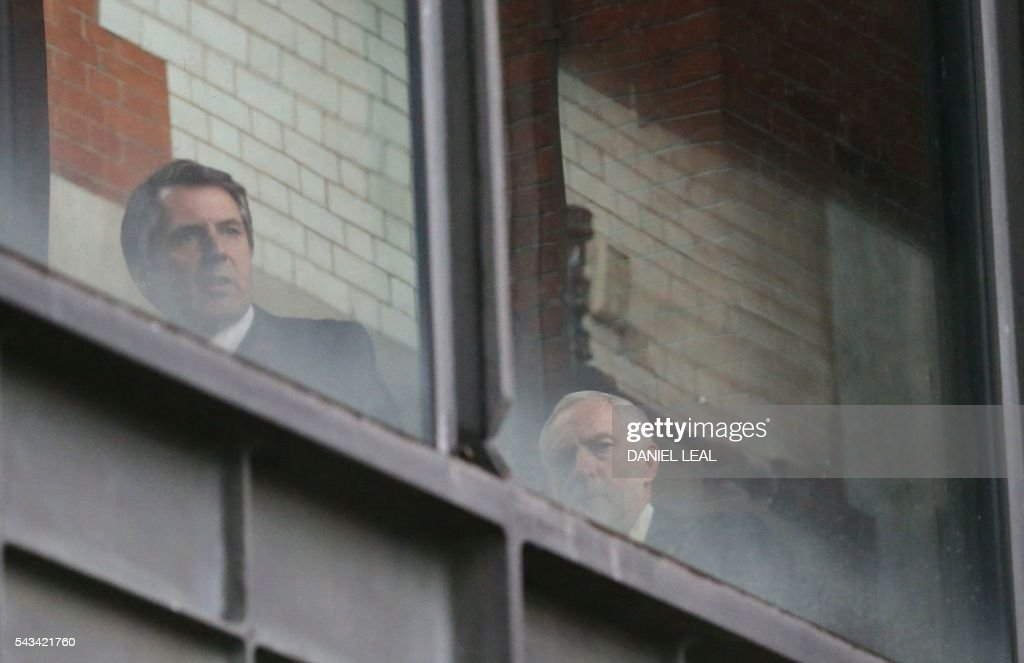 British opposition Labour Party Leader Jeremy Corbyn (R) looks from a window in Portcullis House in central London on June 28, 2016, after he lost a non-binding confidence motion. British Labour Party lawmakers voted massively against their leader on Tuesday amid political turmoil in Britain after a vote to leave the European Union as candidates to succeed Prime Minister David Cameron vied for power behind the scenes. Labour's Jeremy Corbyn lost a non-binding confidence motion, with 172 Labour MPs voting against him and only 40 in favour out of a total of 229 Labour lawmakers in the House of Commons lower house. OLIVAS