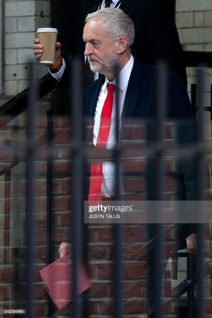 British opposition Labour Party Leader, Jeremy Corbyn makes his way from Portcullis House to the Houses of Parliament in London on June 27, 2016. Top Brexit campaigner Boris Johnson sought Monday to build bridges with Europe and with defeated Britons who voted to remain in the EU in last week's historic referendum. London stocks sank more than 0.8 percent in opening deals on Monday, despite attempts by finance minister George Osborne to calm jitters after last week's shock Brexit vote. / AFP / JUSTIN