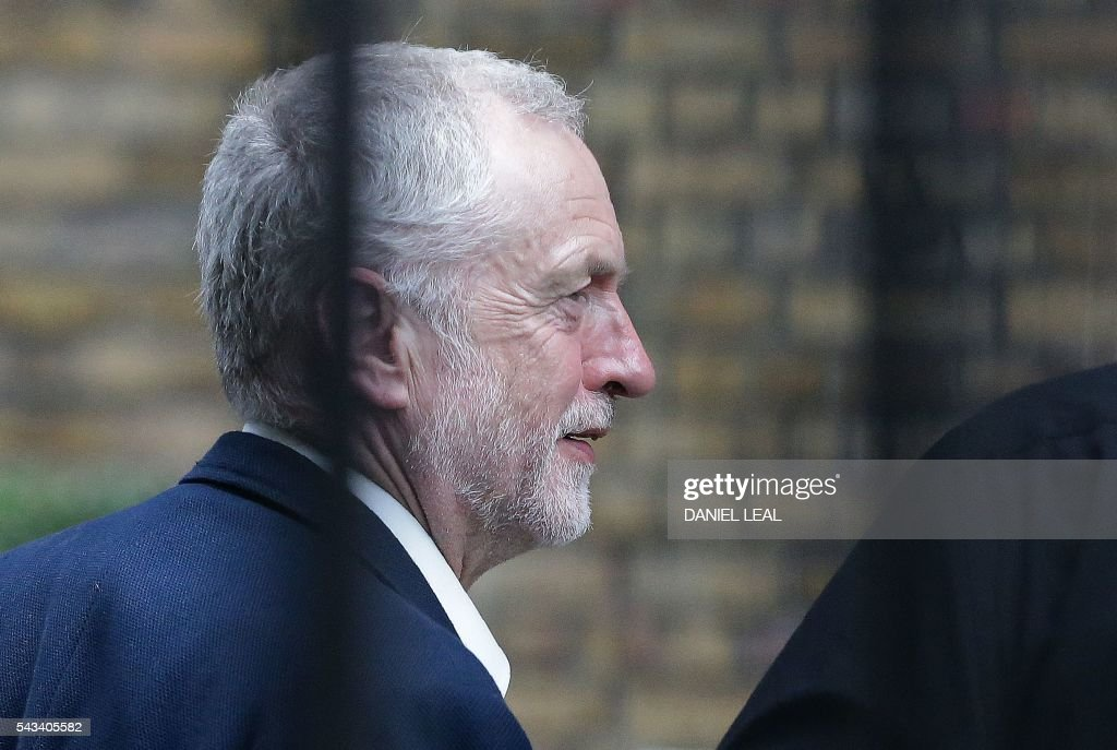 British opposition Labour Party Leader Jeremy Corbyn walks near Portcullis House in central London on June 28, 2016. Around 20 members of Corbyn's shadow cabinet have resigned and the result of a secret ballot of Labour MPs on a no-confidence motion on his leadership is expected to be announced later Tuesday. Five days after Britons stunned the European Union by voting to quit the 28-nation bloc, key European leaders bluntly told Britain they wanted it to leave quickly -- and not expect special treatment. / AFP / DANIEL