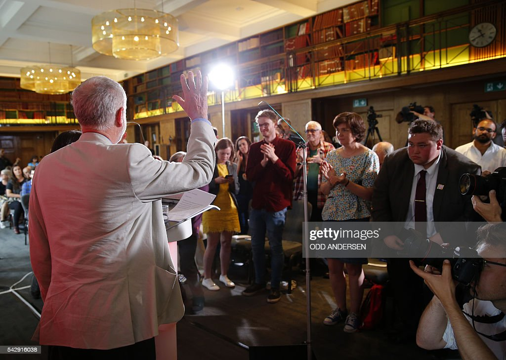 British opposition Labour Party leader Jeremy Corbyn (L) waves to supporters after delivering a speech following the pro-Brexit result of the UK's EU referendum vote, in central London on June 25, 2016. The result of Britain's June 23 referendum vote to leave the European Union (EU) has pitted parents against children, cities against rural areas, north against south and university graduates against those with fewer qualifications. London, Scotland and Northern Ireland voted to remain in the EU but Wales and large swathes of England, particularly former industrial hubs in the north with many disaffected workers, backed a Brexit. / AFP / ODD