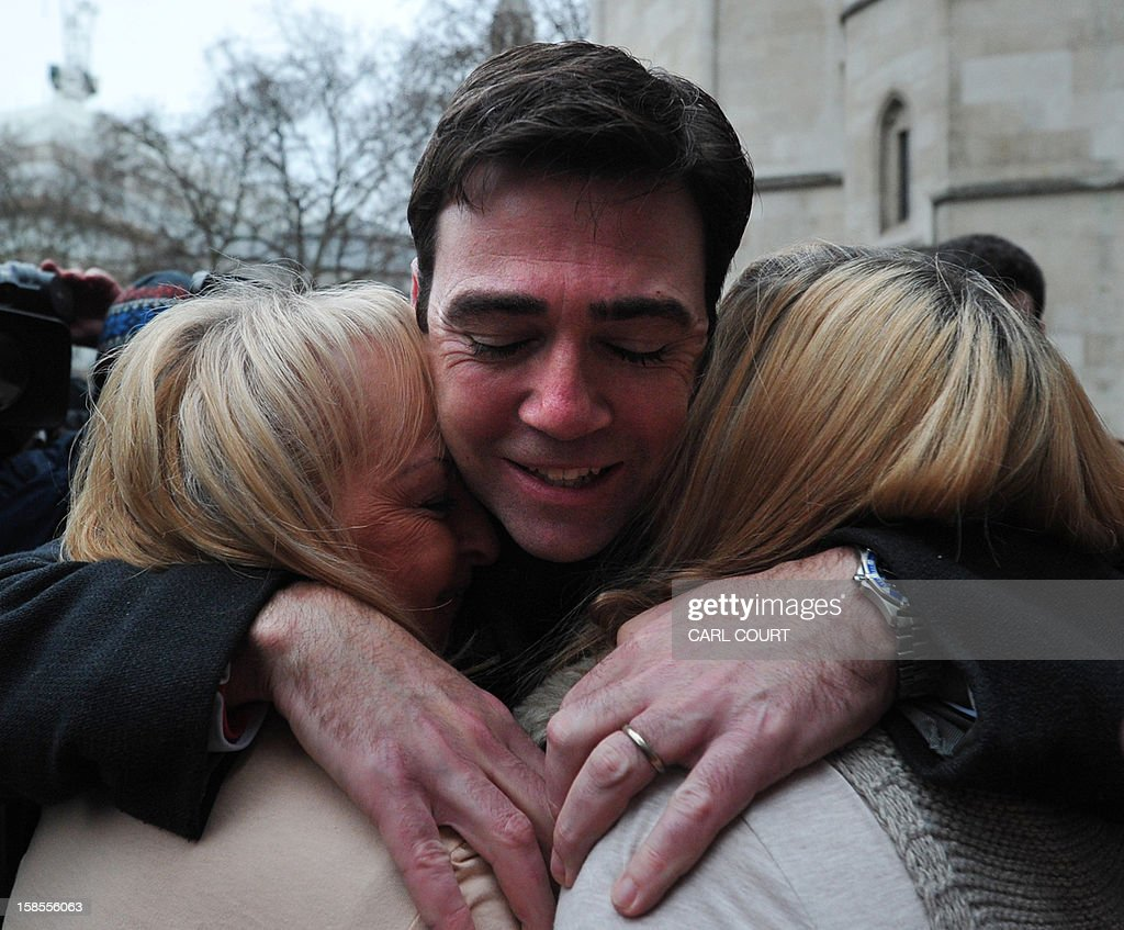 British opposition Labour Party shadow Health Secretary and MP for Leigh, Andy Burnham (C), comforts Margaret Aspinall (R) and Jenni Hicks (L), who both lost relatives in the 1989 Hillsborough disaster, outside the High Court in central London on December 19, 2012, as they react after the High Court quashed the original accidental death verdicts returned on 96 Liverpool football fans who died in the tragedy. The request from the Attorney General to quash the original inquest verdicts follows the publication of a damning independent report in September which concluded that 41 of the 96 people who died would have had the 'potential to survive' if they had received medical treatment more quickly. Attorney General Dominic Grieve called for fresh inquests to be held.