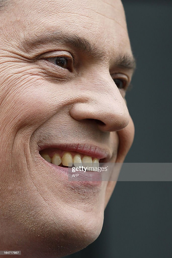British opposition Labour politician and former foreign secretary David Miliband poses on his door step in London on March 27, 2013 after announcing his intention to stand down as a member of parliament. David Miliband, who lost the 2010 battle for the leadership of the opposition Labour party to his younger brother Ed, announced on March 27, he is quitting politics. Miliband is stepping down as a lawmaker to take up the post of president and chief executive of the International Rescue Committee (IRC), a humanitarian organisation based in New York.