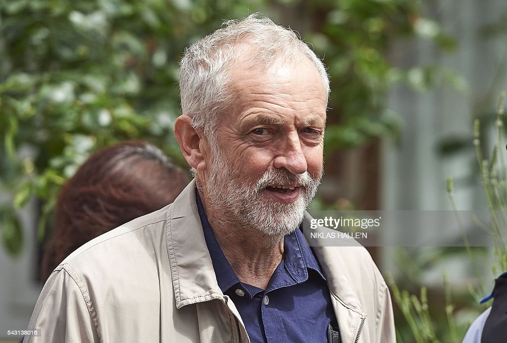 British oppositon Labour Party Leader Jeremy Corbyn leaves his home in London on June 26, 2016. The future of opposition Labour leader Jeremy Corbyn looked shaky on Sunday after two members of his top team quit and others seemed set to follow over his handling of Britain's EU referendum. Corbyn's allies said he had no intention of resigning, but the veteran socialist is facing a revolt over concerns that he is ill-equipped to deal with the fallout from Britain's seismic decision to quit the bloc. / AFP / NIKLAS HALLE'N