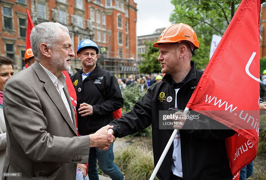 British oppostion Labour Party leader Jeremy Corbyn (L) joins steel workers as they march through central London, on May 25, 2016. Britain's business minister Sajid Javid met Tata Steel bosses in Mumbai ahead of a crunch board meeting on Wednesday expected to discuss potential buyers for its loss-making UK assets. Tata Steel, Britain's biggest steel employer, announced in March that it planned to sell its Port Talbot plant in Wales and other assets, putting 15,000 jobs at risk. / AFP / LEON