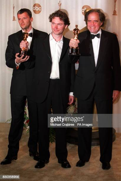 British Oscar winners for the Best Documentary Feature 'One Day In September' Kevin MacDonald with producers John Battsek and American Arthur Cohen...