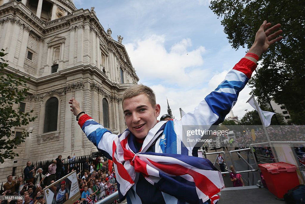 British Paralympic 100m - T35 athlete Jordan Howe waves to the crowds during the London 2012 Victory Parade for Team GB and Paralympic GB athletes on September 10, 2012 in London, England.