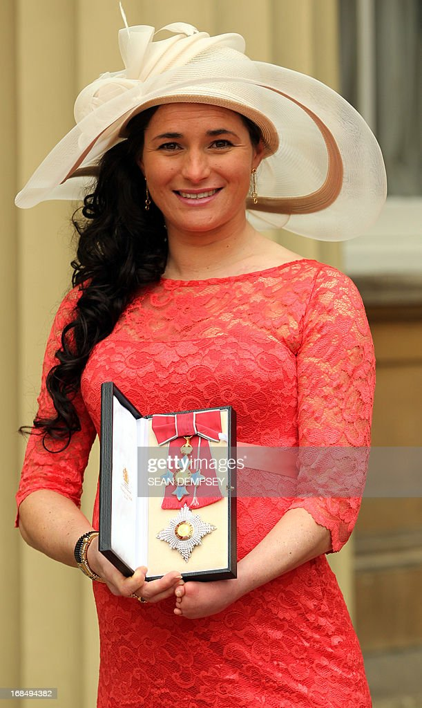 British Paralympic gold medal winning cyclist Sarah Storey poses with her medal after she was appointed a Dame Commander of the Order of the British Empire (DBE) for services to para-cycling by Britain's Prince Charles, Prince of Wales, during an investiture ceremony at Buckingham Palace in central London on May 10, 2013.