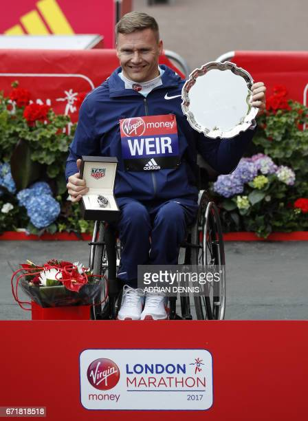 British Paralympic wheelchair athlete David Weir poses after winning the Men's wheelchair marathon on April 23 2017 in London / AFP PHOTO / Adrian...