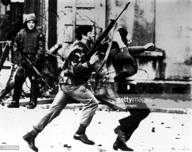 British paratrooper takes a captured youth from the crowd on 'Bloody Sunday' when British paratroopers opened fire on a civil rights march killing 14...