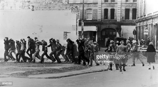 British paratroopers take away civil rights demonstrators on 'Bloody Sunday' after the paratroopers opened fire on a civil rights march killing 14...