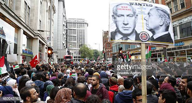British people protest the airstrikes of Israel to Gaza outside the Israeli embassy in London England on July 11 2014 They shout slogans and hold...