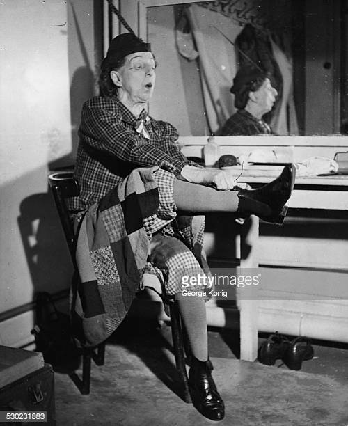 British performer Nellie Wallace putting on her boots before going on stage at the London Palladium circa 1940