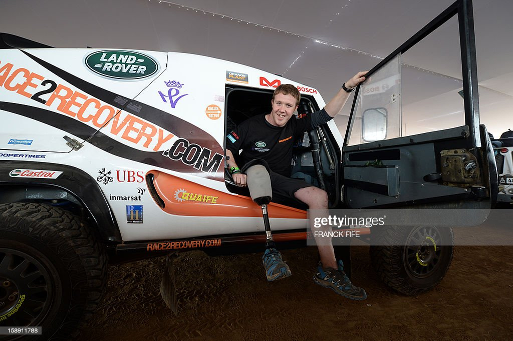 British Philip Gillepsie, of the team Race 2 Recovery consisting of British and American soldiers who have suffered serious injuries in the conflicts in Iraq and Afghanistan in recent years, gets out of his car in Lima on January 3, 2013, ahead of the 2013 Dakar Rally which this year will thunder through Peru, Argentina and Chile from January 5 to 20.