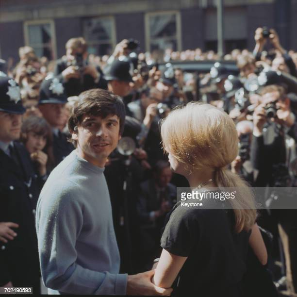 British photographer David Bailey and French actress Catherine Deneuve on their wedding day on the steps of St Pancras registry office London...