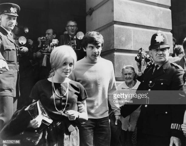 British photographer David Bailey and French actress Catherine Deneuve on the steps of St Pancras registry office London on their wedding day...