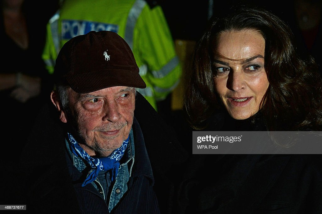 British photographer David Bailey (L) arrives with his wife, model Catherine Dyer (R), attend The Portrait Gala 2014: Collecting To Inspire at National Portrait Gallery on February 11, 2014 in London, England.