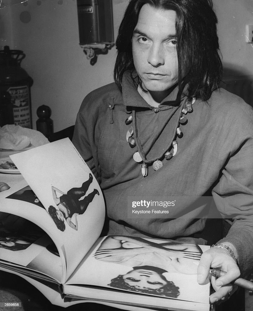British photographer David Bailey flicking through his photographic epitaph to the 1960's, 'Goodbye Baby and Amen'.