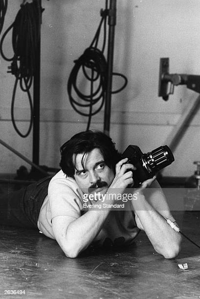 British photographer David Bailey lies the floor as he works on the last session of pictures for Vogue from their studios in Hanover Square London...