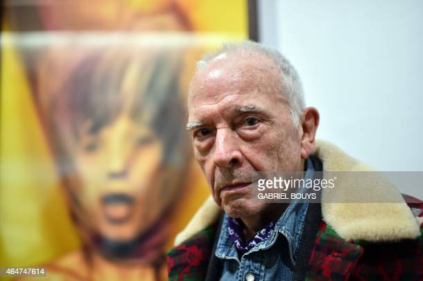 British photographer David Bailey poses in front of his pictures of Mick Jagger during the private preview of the exhibition 'Stardust' on February...
