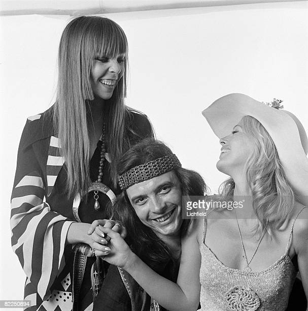 British photographer David Bailey with his girlfriend American fashion model Penelope Tree and Britt Ekland on 9th June 1970