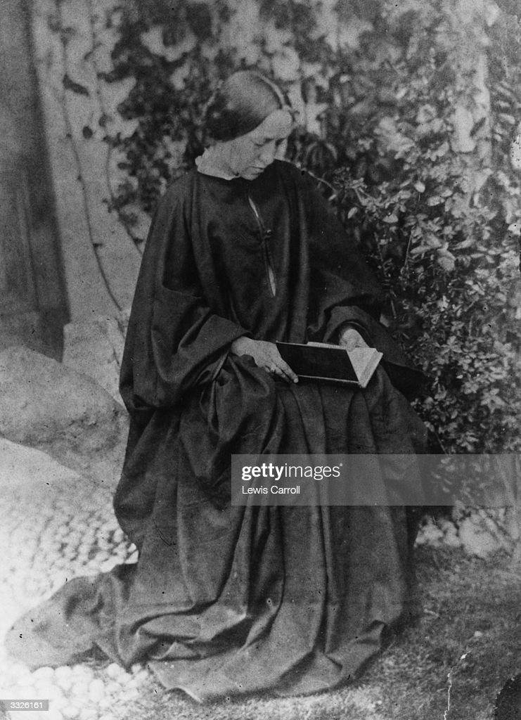 Photographer Julia Margaret Cameron reading a book