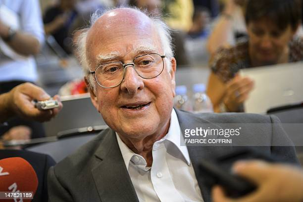 British physicist Peter Higgs smiles at a press conference on July 4 2012 at European Organization for Nuclear Research offices in Meyrin near Geneva...