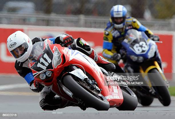 British pilote Steve Plater rides his Honda N°111 ahead of Willian Costes on his Honda N°63 during the Le Mans 24 Hours endurance race first...