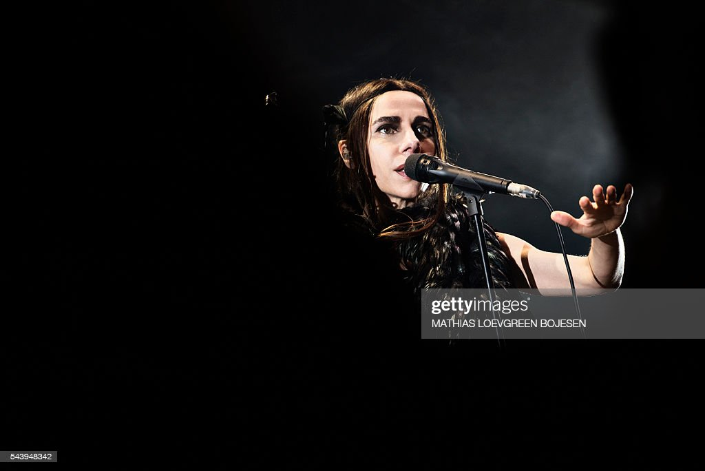 British PJ Harvey performs at the Arena stage at the Roskilde Festival in Roskilde, on June 30, 2016. The festival runs from 25 June to 02 July. / AFP / Scanpix / Mathias Loevgreen Bojesen / Denmark OUT