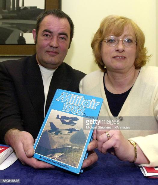 British planespotters Paul Coppin and his wife Lesley from Suffolk during a news conference in London hold up a plane recognition book to the press...