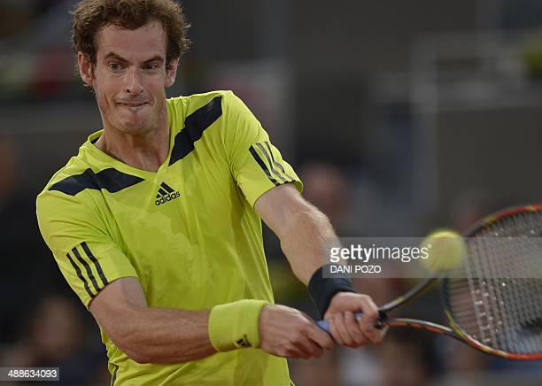 British player Andy Murray returns the ball to Spanish player Nicolas Almagro during their men's singles second round tennis match of the Madrid...