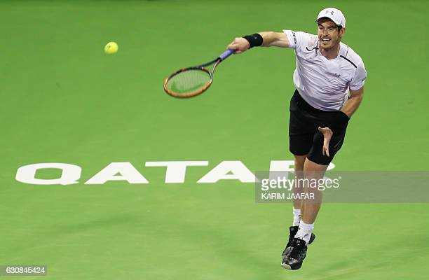 British player Andy Murray serves the ball to France's Jeremy Chardy on the fourth day of the ATP Qatar Open tennis competition in Doha on January 3...