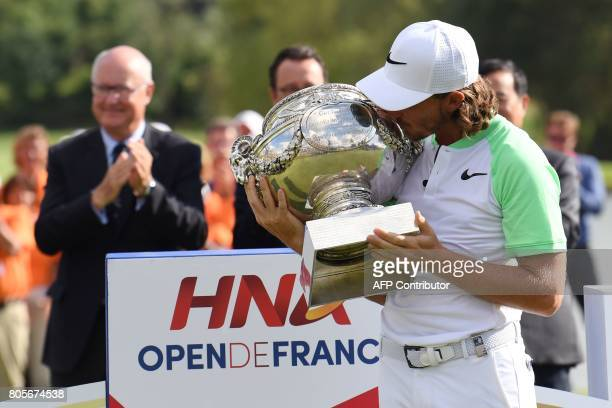 British player Tommy Fleetwood poses with the cup after winning the HNA Open de France golf tournament on July 2 2017 at Le Golf National in...