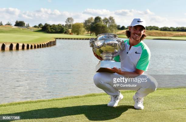 British player Tommy Fleetwood poses with the trophy after winning the HNA Open de France golf tournament on July 2 2017 at Le Golf National in...