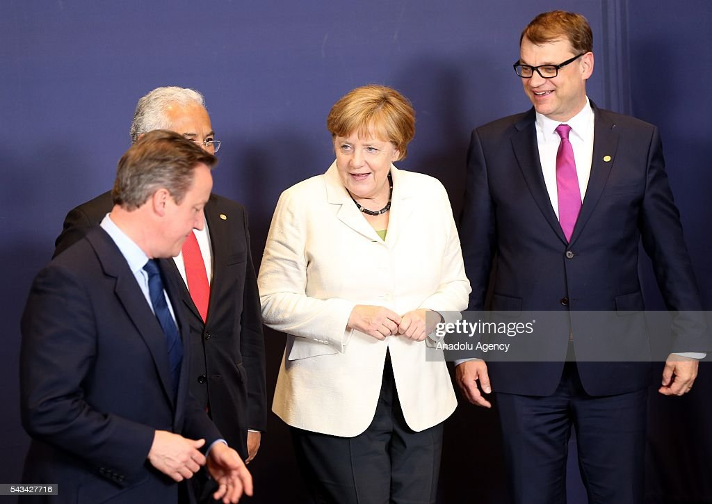 British PM David Cameron (L) and Angela Merkel (2nd R) attend the EU summit meeting on June 28, 2016 at the European Union headquarters in Brussels.