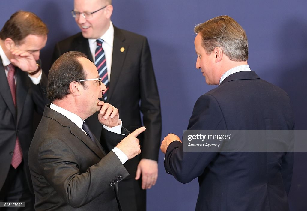 British PM David Cameron (R) and French President Francois Hollande (L) attend the EU summit meeting on June 28, 2016 at the European Union headquarters in Brussels.