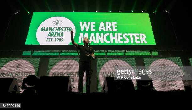 British poet and writer Tony Walsh AKA Longfella speaks during the 'We Are Manchester' charity concert at the Manchester Arena in Manchester...
