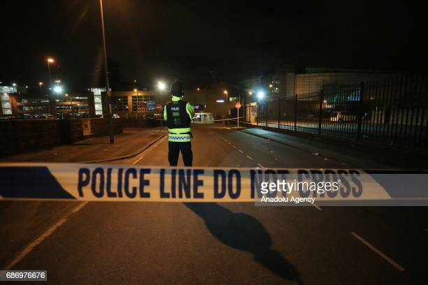 British police guard the entrance to the Manchester Arena stadium in Manchester United Kingdom on May 23 2017 A large explosion was reported earlier...