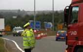 British police help coordinate 'Operation Stack' after a section of the M20 highway was closed to accommodate trucks near Maidstone in the Folkestone...