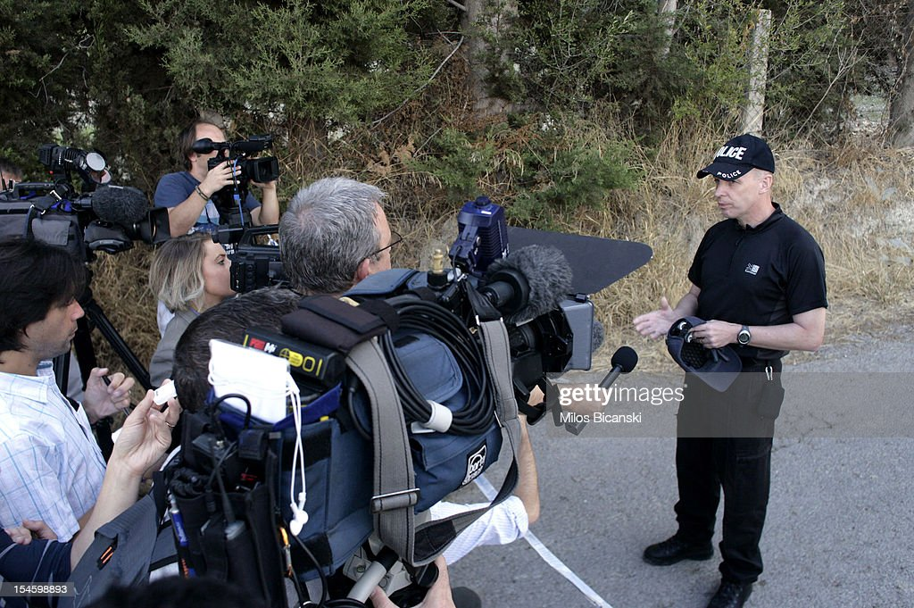 A British police officer makes a statement to the media as the search continues for Ben Needham, who went missing 21 years ago, on October 23, 2012 in Kos, Greece. The toddler from Sheffield was 21 months old when he vanished on the Greek island in July, 1991. Specialist British search teams and Greek police started excavating the site last week.