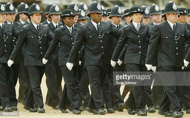 British police officer march during the Metropoitan Police Service's 175th Anniversary service on June 4 2004 in London England The service was...
